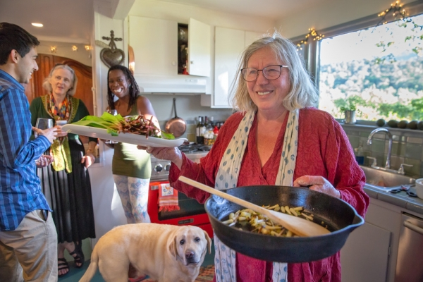 a cast iron skillet and a wooden spoon cooking tools that could hardly be more basic have a home in danna breens kitchen a place also frequented by her - Portola Kitchen